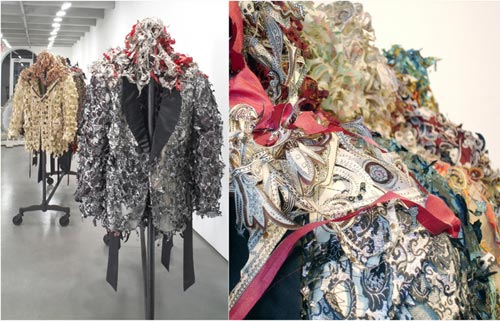 In Twenty Bitches (Tarred and Feathered), I cut along the contours of the pattern in a twenty paisley smoking jackets, reducing this silky symbol of power to a mass of feathery tatters that borders on disintegration. The work, like Fatigue, 2004 (see Underbush), deconstructs the smoking jacket and the inherent power relationship they represent, and hangs them out to dry.