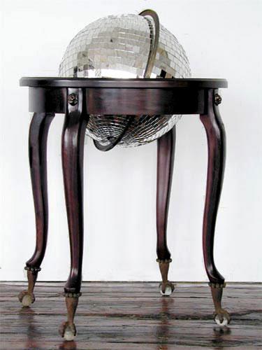 """Disco Globe, 2005 world globe, mirror pieces, wood, 38 x 26 x 26""""."""