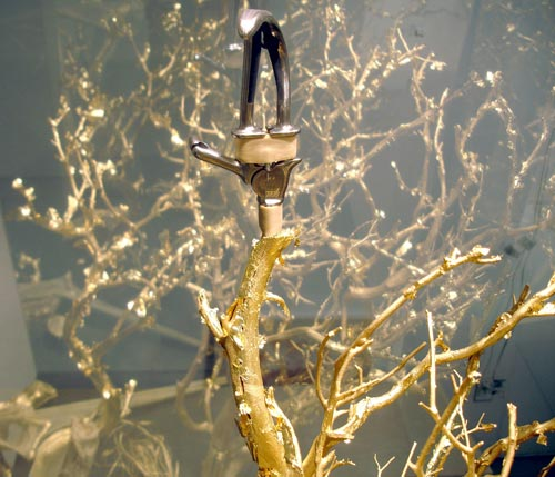 """Golden Ho Bough, 2008, two-way mirrored glass, resin, wood, stockings, prosthetic limbs, 78""""x38""""x38""""."""