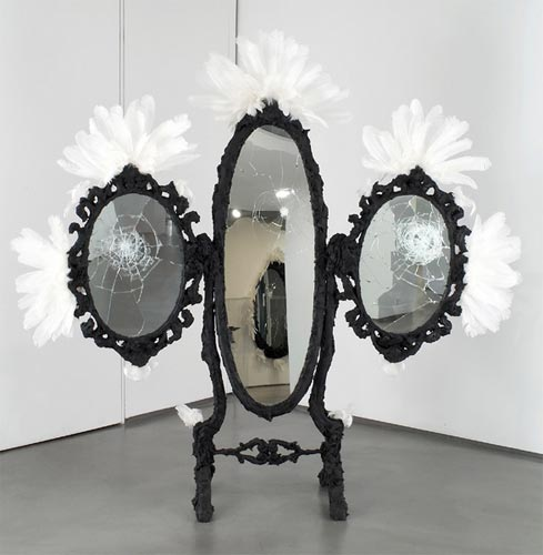 """Tarred and Feathered, 2006 Tar, feathers, mirror, wood, 83"""" x 84"""" x 22""""."""
